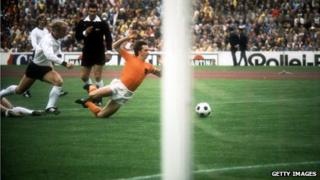 Referee Jack Taylor watches as Johan Cruyff brought down in first minute of the 1974 World Cup final