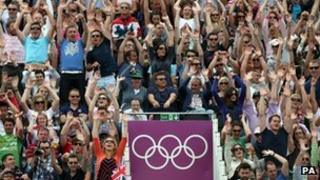 Crowd's watching the Olympics Beach Vollyball