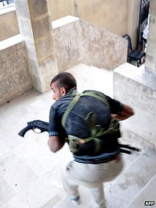 Rebel fighter in the Salhin district of northern Aleppo on 31 July 2012