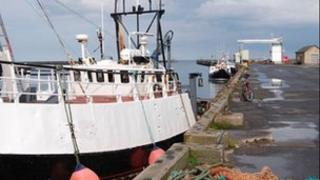 Fishing boats docked on Amble's quayside