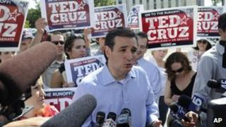 Ted Cruz surrounded by reporters in Houston, Texas 31 July 2012