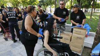 Women receive food parcels from Golden Dawn, 1 Aug 12