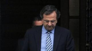 Greek Prime Minister Antonis Samaras leaves talks in Athens' Maximou Mansion with his coalition partners on new spending cuts on 1 August 2012