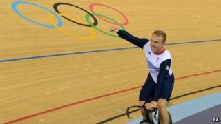 Sir Chris Hoy celebrates his gold medal win
