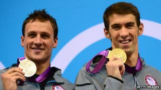 US swimmers Michael Phelps (r) and Ryan Lochte (l) show their gold and silver medals after the men's 200m individual medley swimming event at the London 2012 Olympic Games