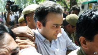 Sanjeev Nanda (C) being taken to prison in 2008 after his conviction