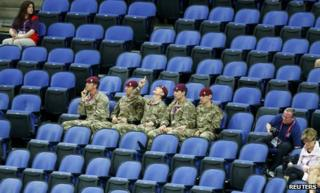 Soldiers fill empty seats at the gymnastics