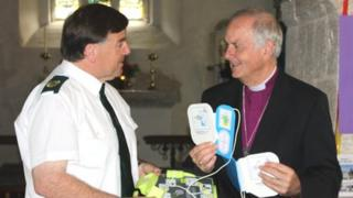 The Archbishop of Wales, Barry Morgan, with Welsh Ambulance Service national Pads manager Gerard Rothwell