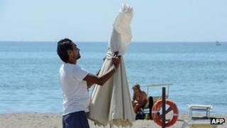 Beach umbrella is folded shut at Lido di Ostia, 3 Aug 12