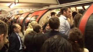 People struggling to get on a Central Line train last week