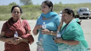 People outside the Sikh Temple in Oak Creek, Wisconsin, where a shooting took place on 5 August 2012