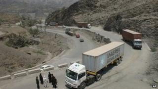 Pakistani border guards check private trucks en-route Afghanistan (File)