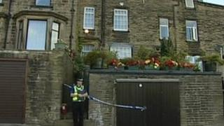 Police outside the house in Haworth