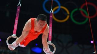 Chen Yibing of China performs on the rings at the London 2012 Olympics