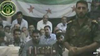 Syrian rebels show off a group said to be Iranian hostages (video grab from YouTube)
