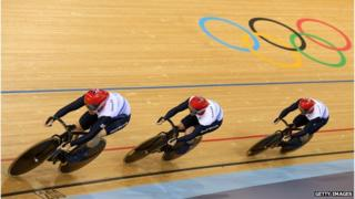 Philip Hinde, Jason Kenny and Sir Chris Hoy compete in the Men's Team Sprint Track Cycling first round in the velodrome at London 2012