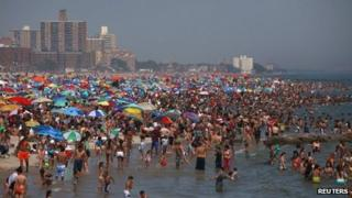 Crowds on the beach at Coney Island, New York 30 June 2012