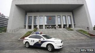 A police vehicle leaves the Hefei Intermediate People's Court, where the Gu Kailai trial is held, 8 Aug 2012