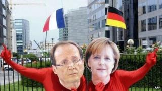 Activists disguised in European leaders French president Francois Hollande and German Chancellor Angela Merkel demonstrate