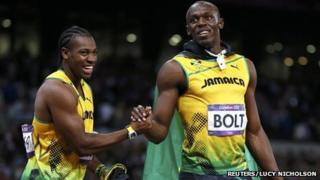 "Jamaica""s Usain Bolt (R) shakes hands with team mate and second-placed Yohan Blake after winning the men's 100m final during the London 2012 Olympic Games"