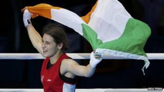 Katie Taylor waves Irish tricolour