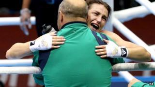 Katie Taylor hugs coach