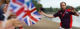 A Games Maker high fives fans in Hyde Park