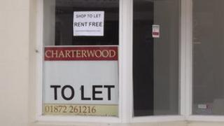 Empty shop with 'Rent Free' sign