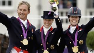 Carl Hester, Laura Bechtolsheimer and Charlotte Dujardin celebrating winning team gold at the London 2012 Olympics