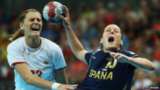 Two female handball players in a match