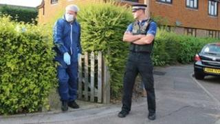 Forensic specialist and policeman