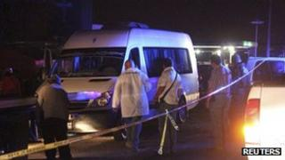 Forensic experts inspect the van in which 14 bodies were found near San Luis Potosi