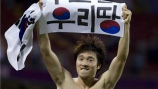 "South Korea""s Park Jong-woo holds up a banner reading ""Dokdo is our Territory"" - 10/8/12"