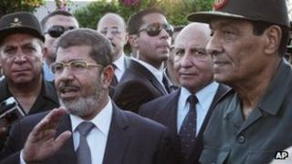 Egyptian President Mohammed Mursi and Field Marshal Gen Hussein Tantawi, right