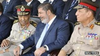 Egyptian President Mohammed Mursi (centre), Field Marshal Mohammed Hussein Tantawi (left) and ex-Chief of Staff Sami Annan. Photo: July 2012