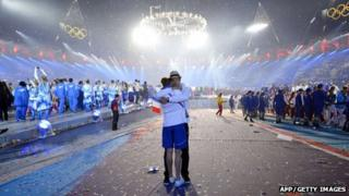 Two athletes hug at the closing ceremony of the 2012 London Olympic Games