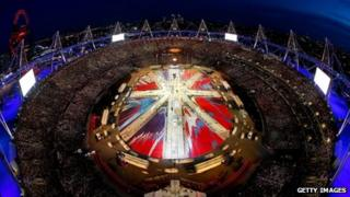 A general view of the stadium as a union jack is formed during the closing ceremony of the London 2012 Olympic Games