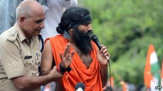 Indian yoga guru Baba Ramdev addresses the media and his supporters after his arrest in New Delhi on August 13, 2012