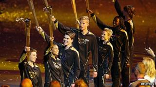 "Seven final torchbearers prepare to light the Olympic Cauldron. Seven teenagers, in keeping with the Games motto of ""Inspire a generation"""