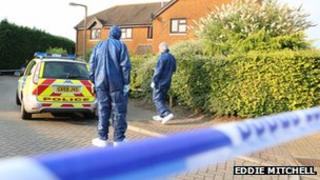 Forensic specialists at the scene