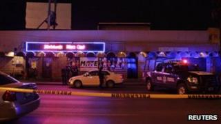 Policemen stand guard at a crime scene in downtown Monterrey