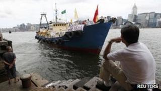 Activists depart on board the Kai Fung 2 fishing trawler for the disputed Senkaku Islands from Hong Kong's Tsim Sha Tsui pier, 12 August 2012