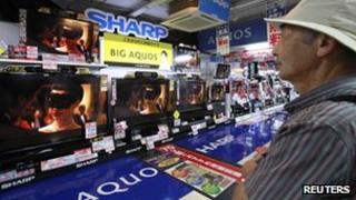A man looks at a Sharp television