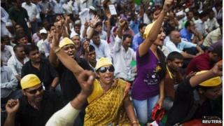 Supporters of veteran Indian social activist Anna Hazare, shout slogans as they take part in a protest in New Delhi July 25, 2012