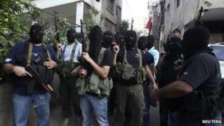 Masked gunmen from the al-Meqdad clan in the southern suburbs of Beirut (15 Aug 2012)