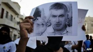 A Bahraini Shiite Muslim youth holds a picture of prominent rights activist Nabeel Rajab during a protest in June 2012