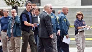 Washington Police and FBI agents outside the Family Research Council in Washington DC on 15 August 2012
