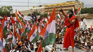 Baba Ramdev addresses supporters on the way to an anti-corruption protest