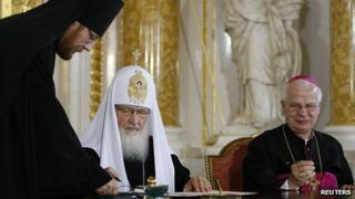 Russia's Patriarch Kirill and Poland's Archbishop Jozef Michalik sign joint appeal, 17 Aug 12