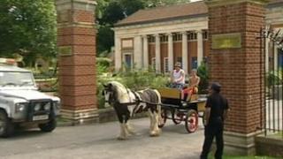 A horse and cart going through Marlborough College gates